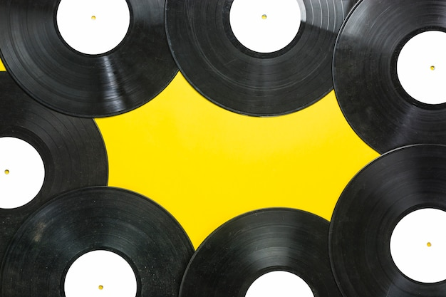 Vinyl records on yellow background