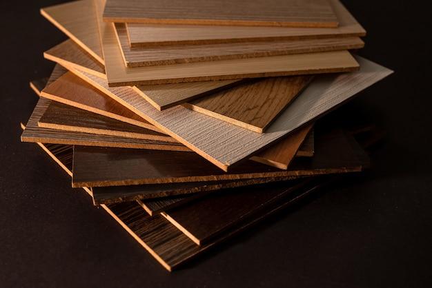Vinyl samples with wooden grain texture on dark background
