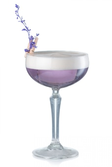 Violet alcohol cocktail with gin and lavender flower isolated