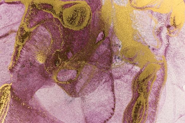 バイオレットとゴールドの水彩インクパターン