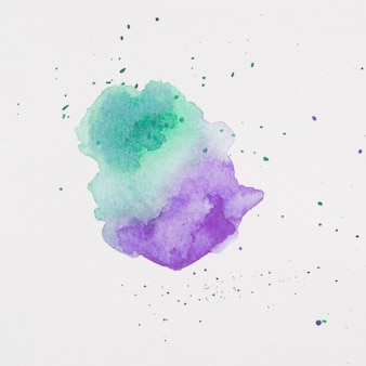 Violet and aquamarine blots of paints on white paper