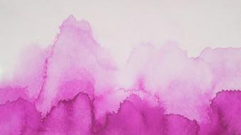Violet blots of paints on white paper