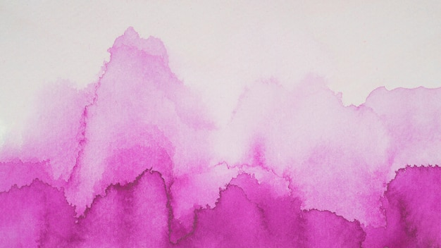 Violet blots of paints on white paper