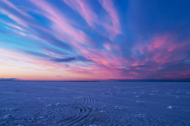 Violet blue sunset in the evening in winter over the river