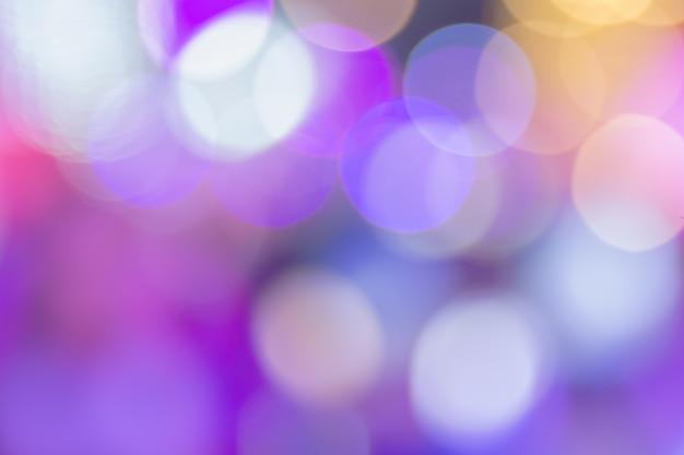 大きな円の壁紙の背景に紫のボケ味。
