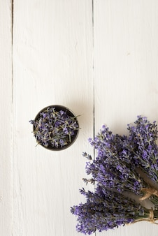 Violet bouquets of fragrant lavender flowers with a piala on white. flat lay
