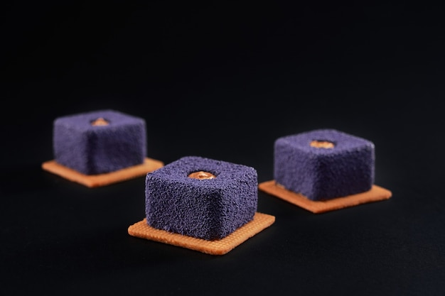 Violet cakes with matte surface on cookies.