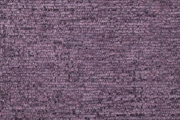 Violet fluffy background of soft, fleecy cloth. texture of textile closeup
