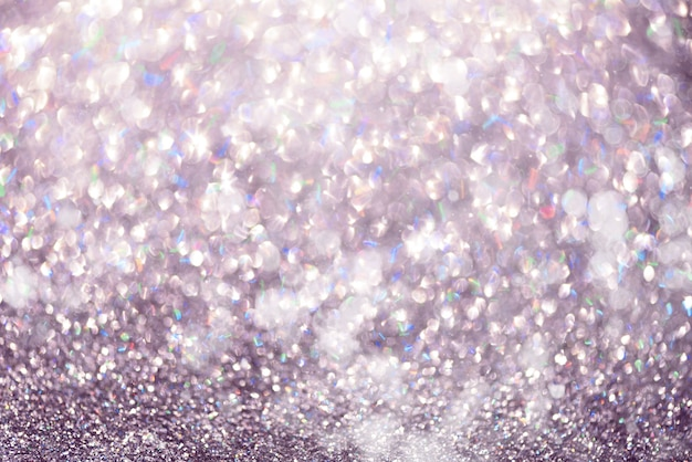 Violet and purple abstract bokeh lights. shiny glitter background with copy space. new year and christmas concept. sparkling greeting card