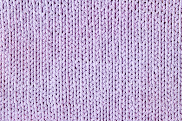 Violet or purple knitted textured background
