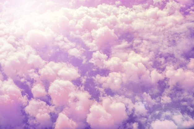 Violet sky with fluffy pink clouds abstract background