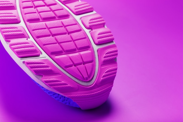 Violet sole of a sports sneaker close-up. sports style, texture, macro