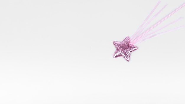Violet star with stick on white copy space background