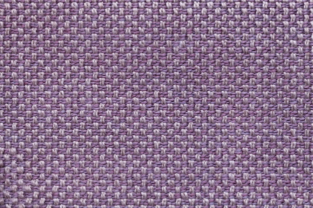 Violet textile background with checkered patterno.