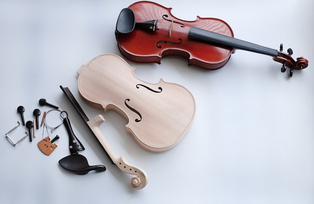 Violin and accessory put beside completed violin