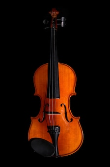 Violin orchestra musical instruments on black background