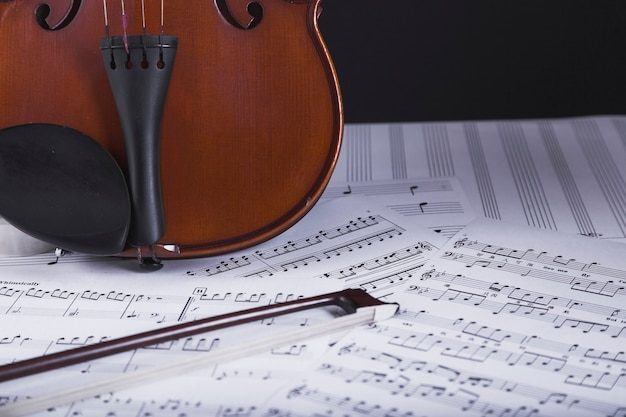 Violin standing on sheet music