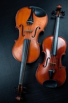 Violin and viola on dark