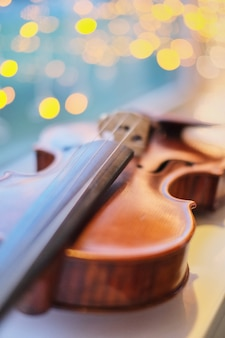 Violin with blurred perspective light blue bokeh background