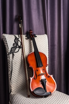 Violin with bow on empty chair
