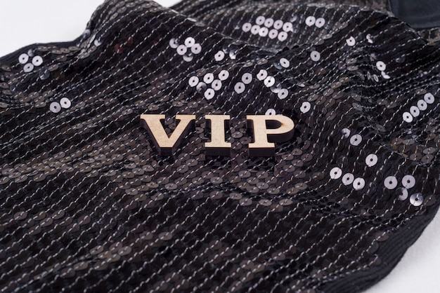 Vip letters on sequin background