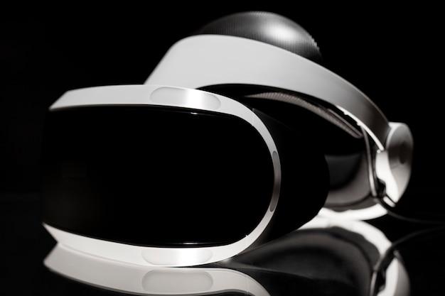 Virtual reality glasses on black background.