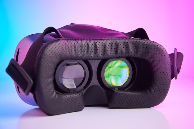Virtual reality glasses on the colorful background. future technology, vr concept