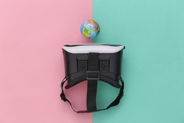 Виртуальное путешествие. гарнитура виртуальной реальности с глобусом на розовом синем фоне. вид сверху