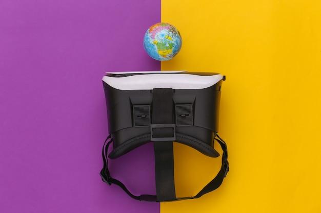 Виртуальное путешествие. гарнитура виртуальной реальности с глобусом на желтом фиолетовом фоне. вид сверху