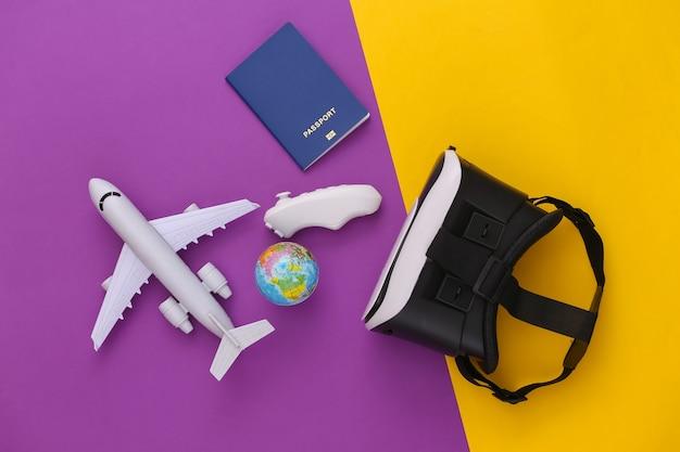 Виртуальное путешествие. гарнитура виртуальной реальности с глобусом, паспортом и самолетом на пурпурно-желтом фоне. вид сверху