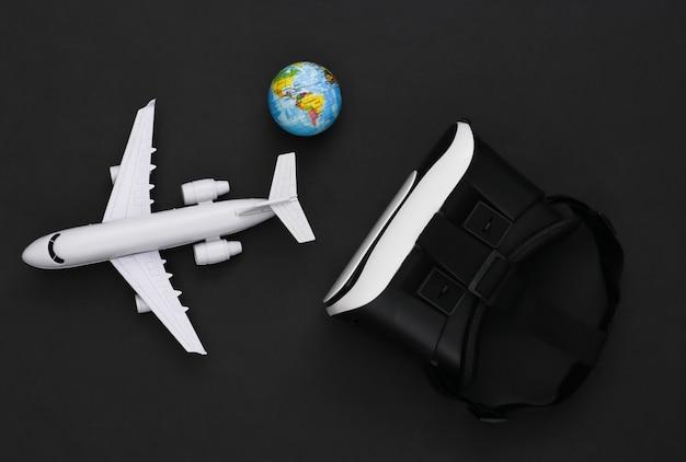 Виртуальное путешествие. гарнитура виртуальной реальности с самолетом, глобусом на черном фоне. вид сверху