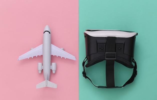 Виртуальное путешествие. гарнитура виртуальной реальности с самолетом на розовом синем фоне. вид сверху