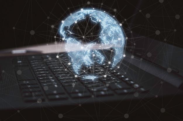 グローバルネットワークの概念のためのコンピュータラップトップ上の仮想世界と接続線。