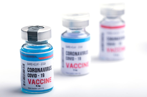 Virus vaccine development of a coronavirus covid-19, vaccine bottle in concept of insurance and fight against coronavirus 2019 ncov cure, medical research in laboratory to stop the spread of the virus