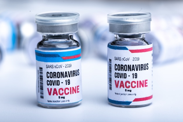 Virus vaccine on white background in science laboratory, coronavirus covid-19 disease medicine infection epidemic flu, health care research