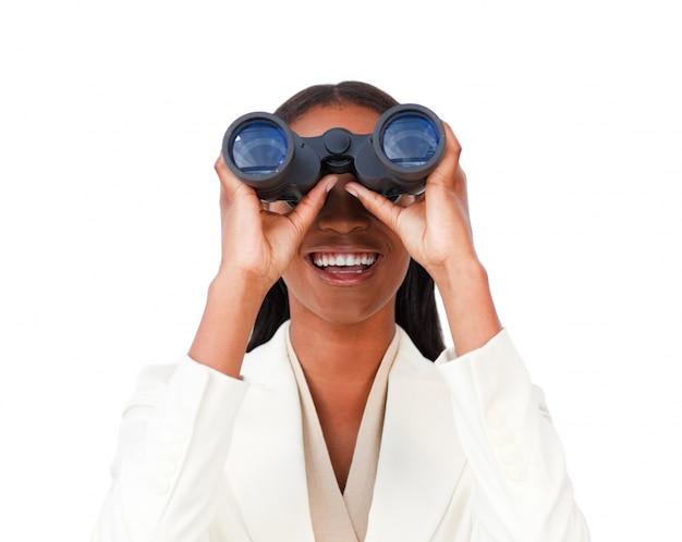 Visionary businesswoman looking through binoculars