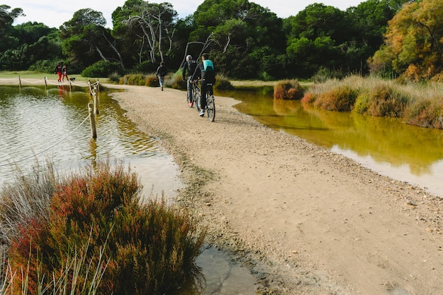 Visitors to the natural park of albufera de valencia, strolling along the paths