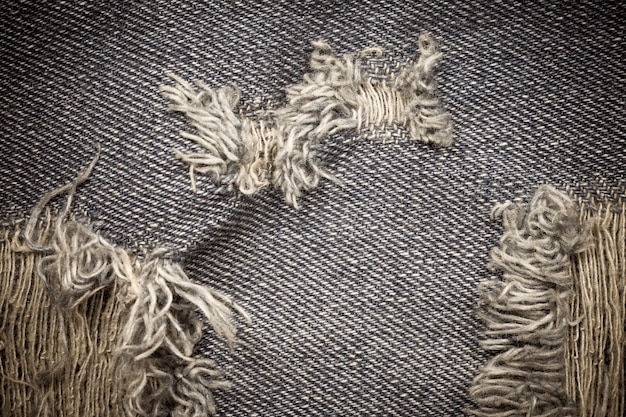 Vitage torn denim jeans texture.