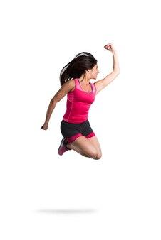 活力と運動の女の子は非常に素早くジャンプします