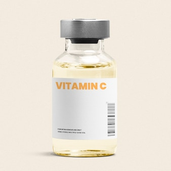Vitamin c injection in a glass bottle vial with yellow liquid