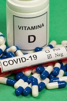 Vitamin d container with capsules around