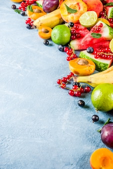 Vitamin food concept, various fruit and berries watermelon peach mint plum apricots blueberry currant