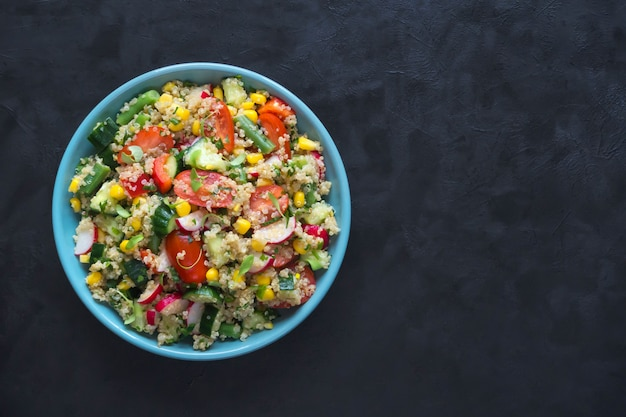 Vitamin salad with quinoa and corn. top view with copy space.