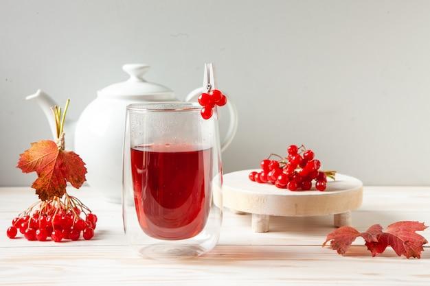Vitamin tea from viburnum berries in a glass transparent mug