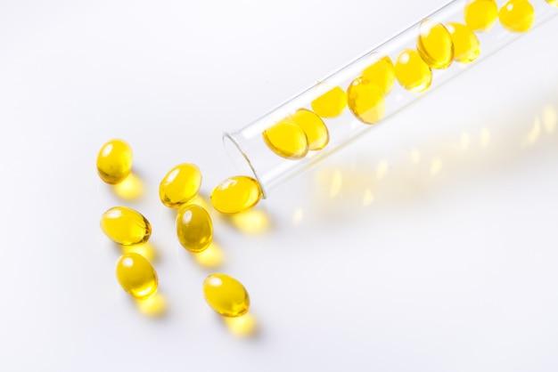 Vitamins d capsules piles in glass bottle