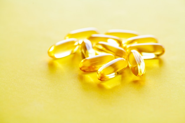 Vitamins supplements, fish oil in yellow capsules omega 3.