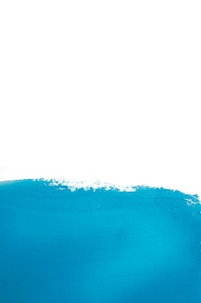 Vivid blue colored paint brushstroke