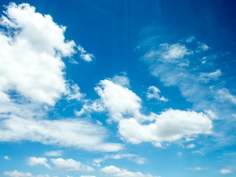 Vivid blue sky with group of white clouds.