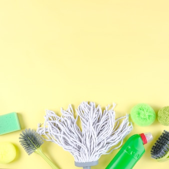Vivid cleaning items on yellow background