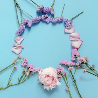 Vivid colorful flowers forming circular frame